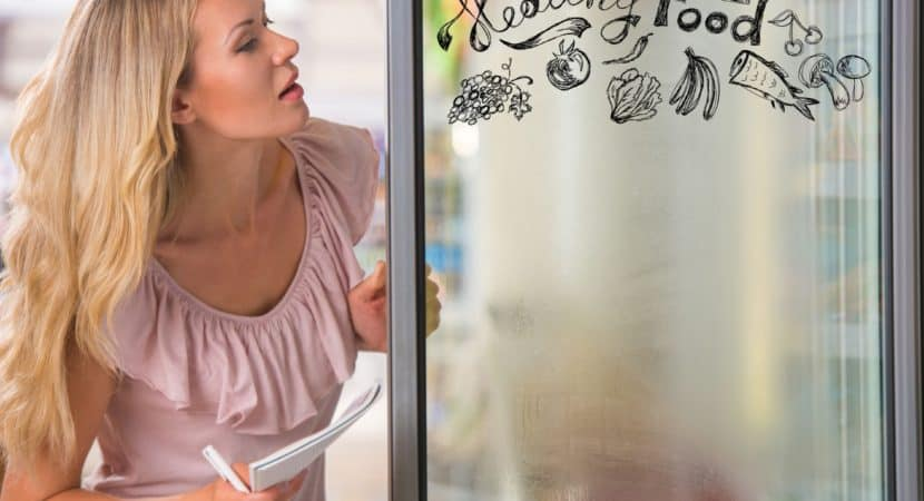 Young pretty woman thinking of healthy food while shopping at grocery store