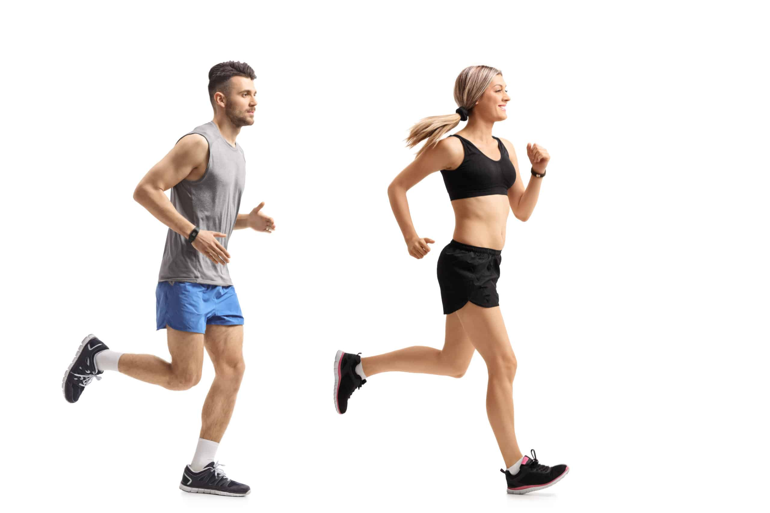 Full length profile shot of a young man and a young woman runnin