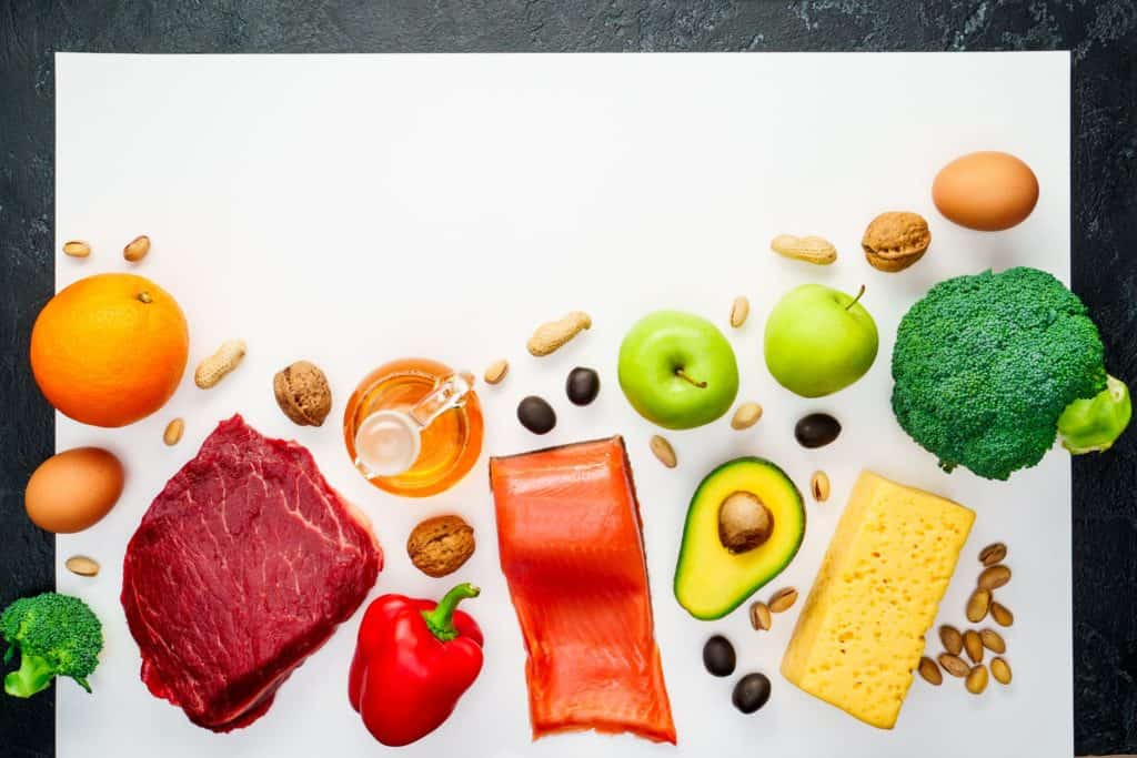 Photo of useful products for diet on white surface.